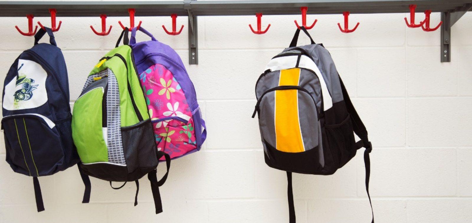 backpacks-hanging-on-hooks 1