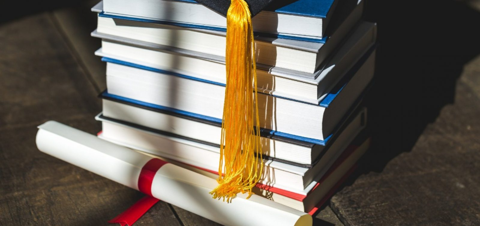 grad-cap-diploma-and-books-stacked 1